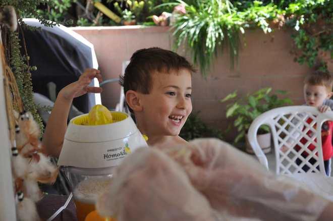 Noah extracting some juice